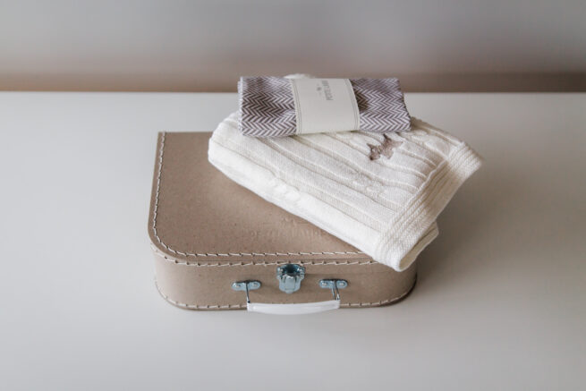 Welcome Baby gift set: Scandinavian baby blanket  and muslin baby bamboo swaddle packed in our elegant suitcase with our logo.